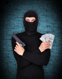 Terrorist holding gun and dollars Royalty Free Stock Photo