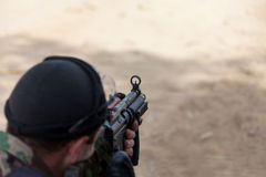 Terrorist holding at gunpoint Stock Photo
