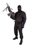Terrorist with machine gun. Isolated Stock Photo