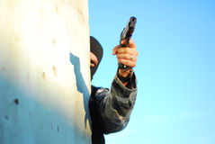 Terrorist with mask and gun Stock Image