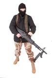 Terrorist med maskingeväret m60 Arkivfoto