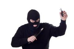 Terrorist met mes en granaat. Royalty-vrije Stock Foto's