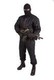 Terrorist mit Maschinengewehr stockfotografie