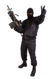 Terrorist mit Maschinengewehr lizenzfreie stockfotos