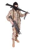 Terrorist mit Maschinengewehr stockfotos