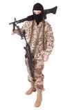 Terrorist mit Maschinengewehr lizenzfreie stockbilder