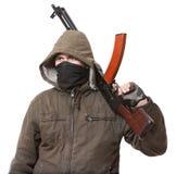 Terrorist mit Waffe stockfotos