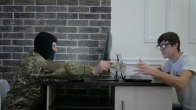 Terrorist pay money to computer hacker, hand to hand, sitting stock footage