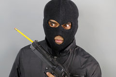 Terrorist with a pencil in his weapon. Terrorist dissatisfied with a pencil in his weapon royalty free stock photos
