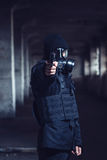 The terrorist pointing gun Stock Images