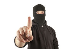 Terrorist pushing the virtual button. Man with mask pushing the virtual button royalty free stock photo