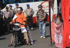 Terrorist reconstruction. Arrested terror suspects Bayu Setyono and his partner shooting a policeman in Solo city in central Java island on April 3, 2013 during Stock Image