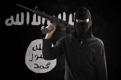 Terrorist with rifle and flag Royalty Free Stock Image
