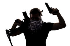 Terrorist or Sepcial Ops Soldier. Ambiguous silhouette of a terrorist or a soldier with a rifle and a handgun. The character can either be a villain or a hero stock photo