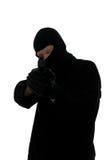 Terrorist taking aim. Terrorist all in black taking aim with a handgun stock photos