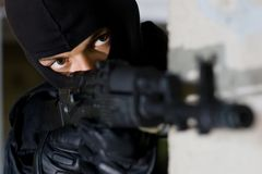 Terrorist targeting with a gun Stock Image