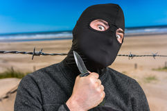 Terrorist threatening western countries with knife Stock Images