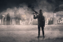 Terrorist with weapon after attacking the city Royalty Free Stock Photos
