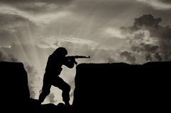 Terrorist with a weapon in trenches against sky in smoke. Terrorist with a weapon in trenches against the sky in smoke. concept of conflict and war Stock Images