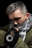 Terrorist whit gun. Terrorist in shemagh whit gun, isolated in black background royalty free stock photo