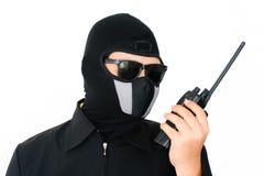 Terrorista con i sunglass ed il walkie-talkie Fotografia Stock