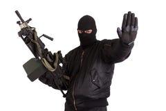 Terrorista con la ametralladora aislada Fotos de archivo