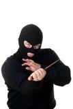 Terrorista nella mascherina nera con la lama. fotografia stock