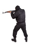 Terroriste avec la kalachnikov AK-47 photographie stock libre de droits