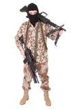Terroriste avec la mitrailleuse photographie stock libre de droits