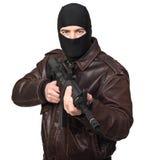 Terroriste avec le fusil image stock