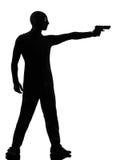Terroriste criminel de voleur visant l'homme d'arme à feu photo stock