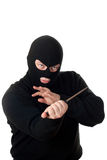 Terroriste dans le masque noir avec le couteau. Photo stock