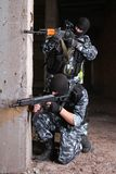 Terrorists in black masks with guns Stock Images