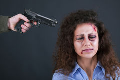 Terrorists threatening the a frightened girl with gun Royalty Free Stock Photo