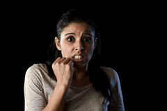 Terrorized and horrified  woman desperate and scared isolated on black Royalty Free Stock Image