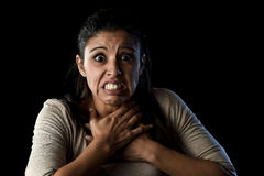 Terrorized and horrified  woman desperate and scared isolated on black Stock Photography