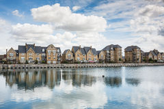 Terrrace houses by a marina. Stock Images