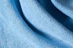 Terry cloth in weaves. Close up of light blue terrycloth Stock Photography