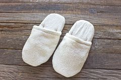 Terry house slippers on  wooden floor Royalty Free Stock Photos