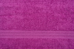 Terry lilac colored cloth towel Royalty Free Stock Photo