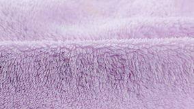 Terry lilac colored cloth towel texture as a background.  stock video