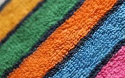 Terry pile structure huckaback towel fabric multicolored striped diagonal close up view royalty free stock photography