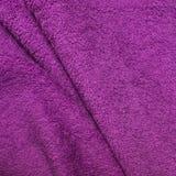 Terry towel, magenta color fuchsia, texture. Terry towel, magenta color fuchsia, texture royalty free stock photos