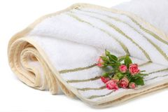 Terry towel with a small bouquet of roses Royalty Free Stock Image