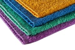 Terry towels. Colorful terry towels stacked up isolated on white Royalty Free Stock Images