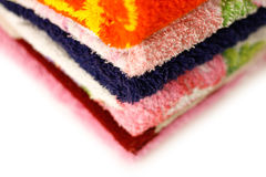 Terry towels of different colors. Closeup. Isolated on a white b Stock Photo