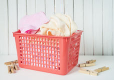 Terry towels in laundry basket Stock Photo