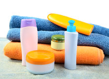 Terry towels and tubes with cosmetics  Royalty Free Stock Image