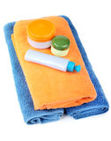 Terry towels and tubes with cosmetics on a white Stock Photo