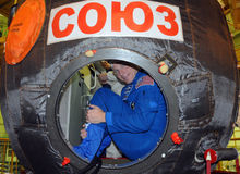 Terry Virts in Soyuz Spacecraft During Fit Check. ISS Expedition 42-43 NASA flight engineer Terry Virts looks out from the hatch of the Russian Soyuz TMA-15M Stock Photo